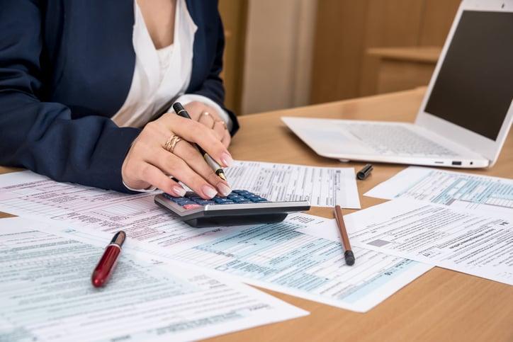 A accountant works on a tax return