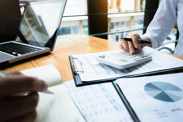 An accountant calculates business tax credits.
