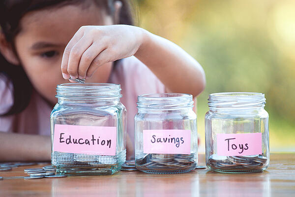A child learn the concept of saving.