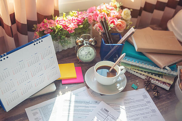 A work desk is all set up for income tax preparation.